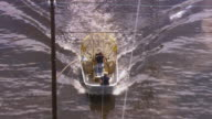 Airboat propelling in flood water near prison / United States
