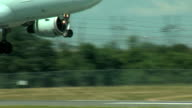 Airbus A320 Jet Airplane landing closeup of wheels touching