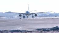Airbus A330  Airplane heads to the runway WideShot - Winter