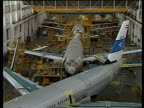Airbus Airbus ITN LIB 18184 Airbus Industrie Assembly Plant TS A320's being assembled PULL TS Workmen attaching wing of A320 GV Interior men working...