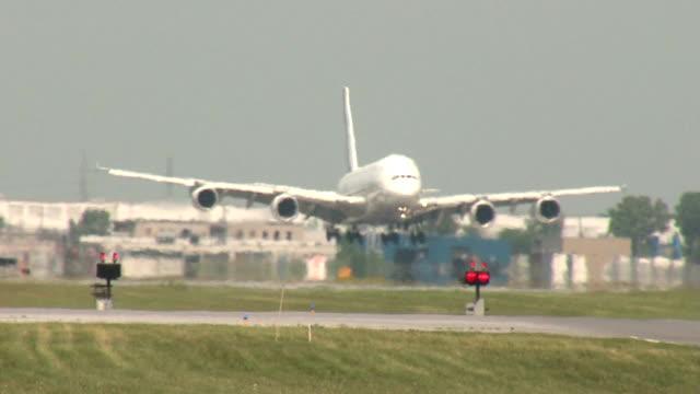 AirbusA380 SuperJumbo Jet Airplane Landing Closeup on a hot day