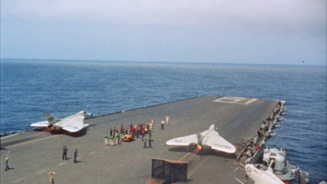 WS Aircraft carrier deck military jet airplanes take off