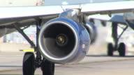 Aircraft engine running at fullthrottle on runway at Heathrow as it prepares for takeoff Unidentified British Airways shorthaul jet
