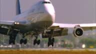 CU, PAN, SLO MO, Aircraft landing on airstrip, Los Angeles, California, USA