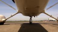 Aircraft taxiing to runway, beautifull low angle shot