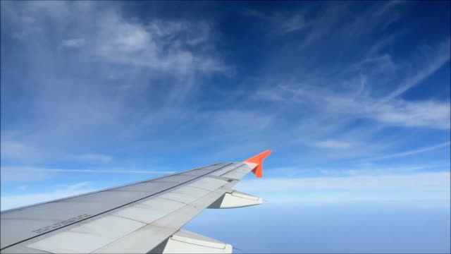 Aircraft wing flying through the clouds.