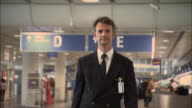 MS TS Airline pilot walking through airport/ Munich, Germany