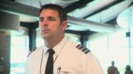 MS Airline pilot walking through terminal, Appleton, Wisconsin, USA