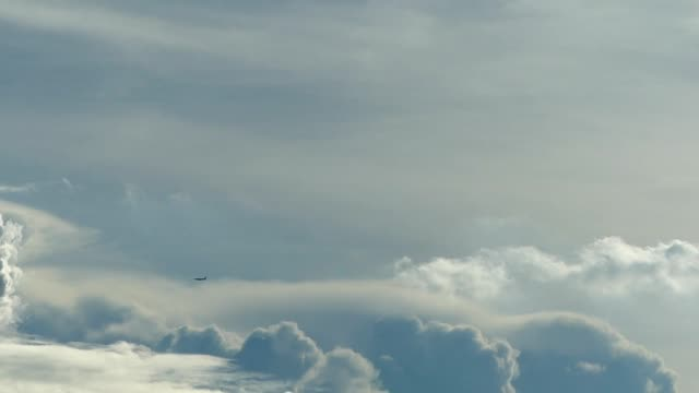 Airplane and moving clouds