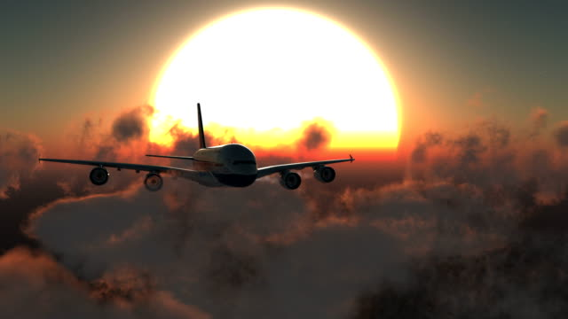 Airplane Flying at Sunset