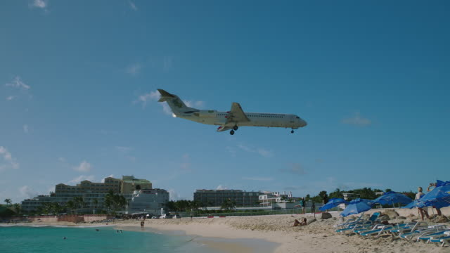 WS TS Airplane flying over Maho beach / St. Maarten