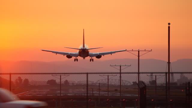 HD airplane landing at sunset