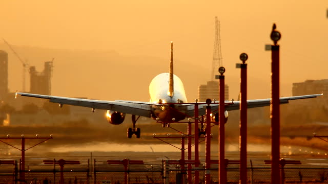 HD airplane landing at sunset