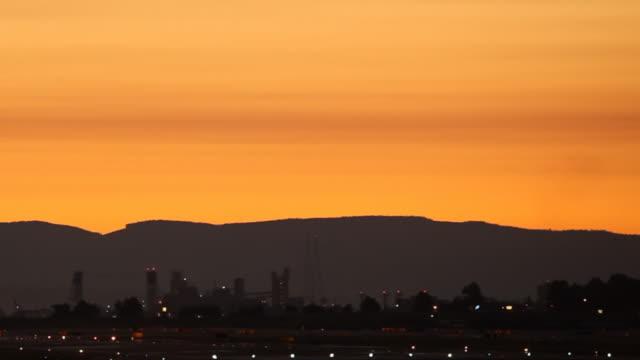 HD airplane landing in sunset
