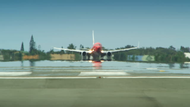 Airplane lands on an airport runway.