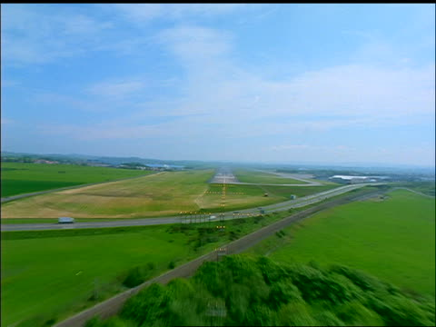 AERIAL airplane point of view green countryside to landing on runway / Prestwick Airport, Ayrshire, Scotland