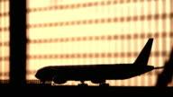 Airplane preparing for take off at sunset