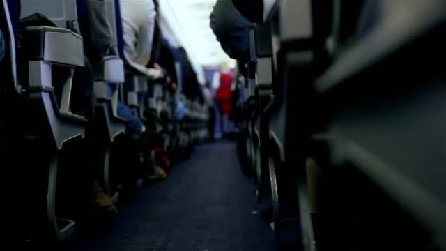 Flugzeug Travel.Stewardess und Passagiere bei einem Flug