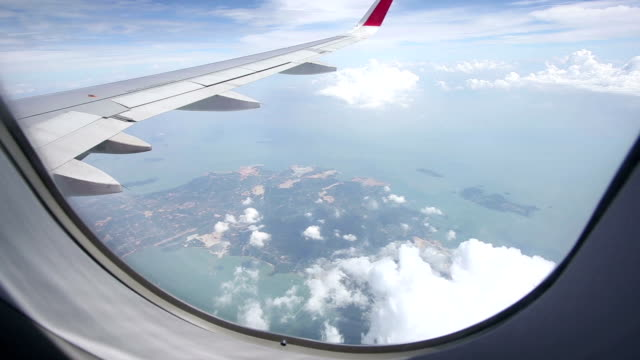 Airplane window view during flight.Real time.