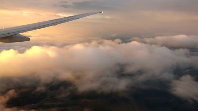 Airplane wing and sky view from window at dusk