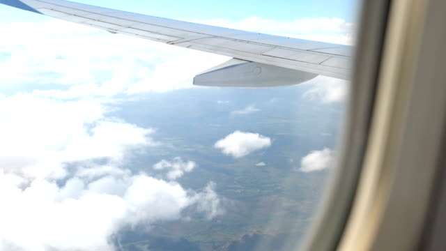 Airplane wing and sky view from window