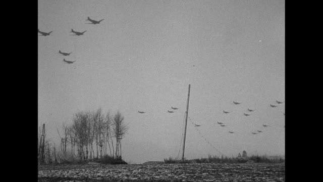 VS C47 airplanes fly in formation over the Western Front as they carry supplies to 101st Airborne Division which is under siege in Bastogne some fly...