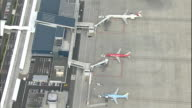 Airplanes line a tarmac at Mt. Fuji Shizuoka Airport in Japan.