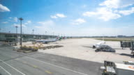 airplanes on air field of tianjin airport in blue sky. timelapse 4k