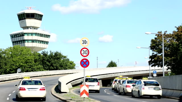 Airport control tower with street and taxis