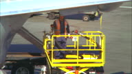 MS, Airport ground crew worker refueling aircraft then closing aircraft fuel panel, Los Angeles, California, USA
