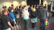 Airport passport security checks Shows interior shots passenger having their passport scanned and queue for passport checks on October 23 2014 in...