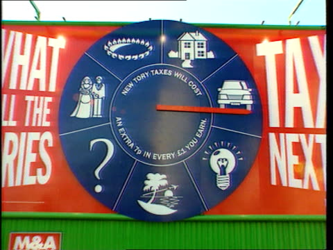 Airport tax launch/Interest rate rise possible EXT Vauxhall Bridge Road Vars shots Labour Economics team unveil new poster 'What will the Tories Tax...