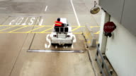 Airport workers on motorized vehicles