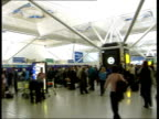 Airports fire service and security staff to strike ENGLAND Stanstead Airport GVs Passengers queuing at checkin desks