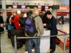 Airports fire service and security staff to strike ITN Security guards checking passengers passports Sign warning of additional searches prior to...