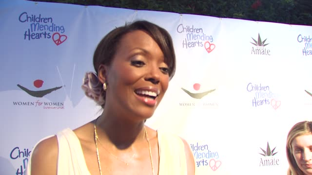 Aisha Tyler on on being a part of the night the importance of art education who she's wearing with a fashion shot at the Children Mending Hearts Gala...