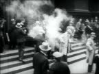 Al Capone entering building with crowd in front