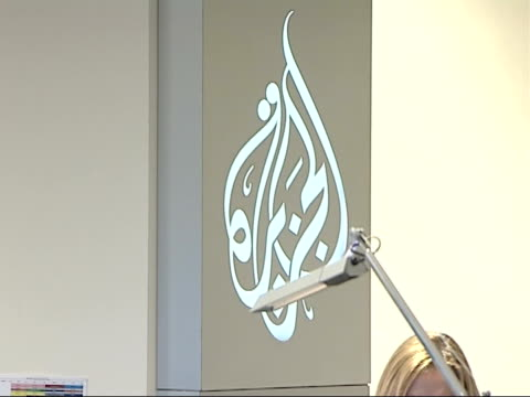 Al Jazeera TV Channel launches English language service Various of Al Jazeera newsroom staff sat working at desks / Al Jazeera logo on wall / More of...