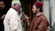 Al Shabaab video appears to threaten British muslims ENGLAND London EXT Imam Ajmal Masroor talking with people outside mosque Ajmal Masroor interview...