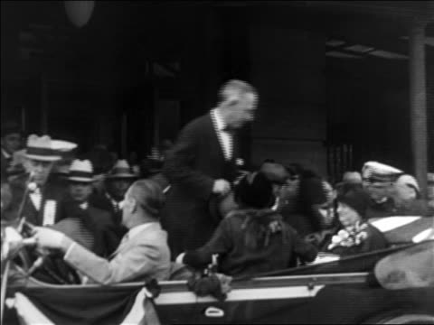 Al Smith getting into crowded car during campaign / titles read 'Omaha' / documentary