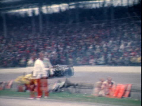 Al Unser Sr racing Parnelli Offenhauser past grandstands leading pack at Indianapolis Motor Speedway / Lee Kunzman racing Eagle Offenhauser / Rear...