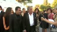 Alain Delon and guest at the amfAR Cinema Against AIDS Gala at Antibes