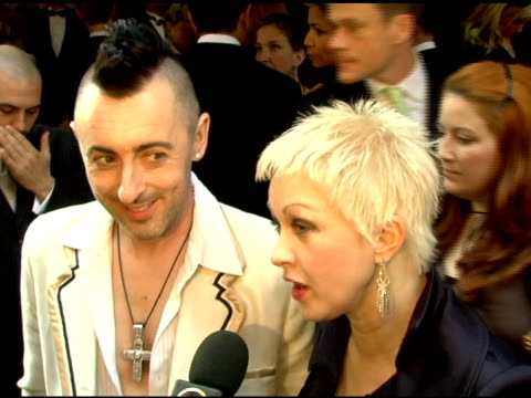 Alan Cumming and Cyndi Lauper of 'The Threepenny Opera' on rehearsing and pulling each others' tongues at the 60th Annual Tony Awards at Radio City...