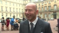 Alan Shearer interview and photocall ENGLAND London Buckingham Palace EXT Alan Shearer along and interview SOT Alan Shearer photocall with CBE medal...
