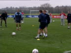 Alan Smith charged over bottle incident ITN England team kicking ball to each other England players jogging round pitch
