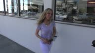 Alana Stewart give a homeless man money while shopping on Bedford in Beverly Hills Celebrity Sightings on Aug 27 2015 in Los Angeles California