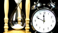 Alarm clock and Hourglass - Time Lapse