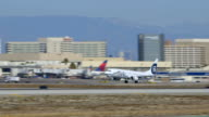 Alaska Airlines Boeing-737 takes off from LAX, daytime