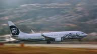 Alaska Airlines jetliner races down runway for take-off at San Francisco International airport