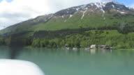 Alaska con vista mare, piano-Sciatrice